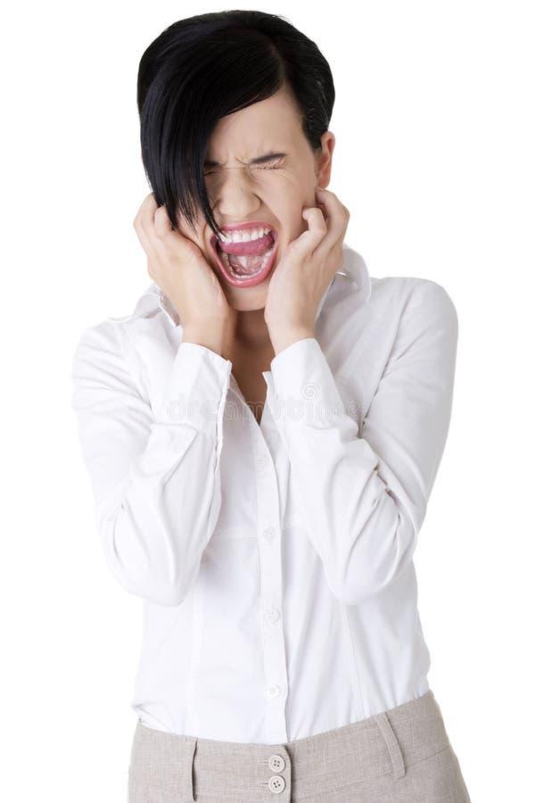 Mulher de negócios irritada que grita fotografia de stock