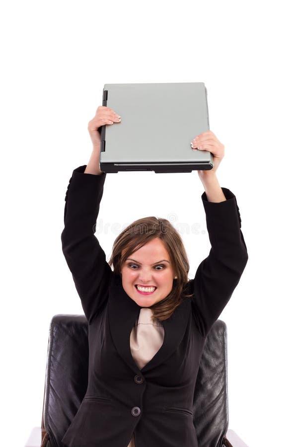 Mulher de negócios irritada que joga seu portátil fotografia de stock royalty free