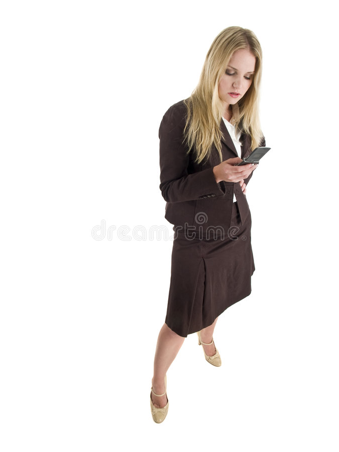 Mulher de negócios loura com telefone de pilha imagem de stock