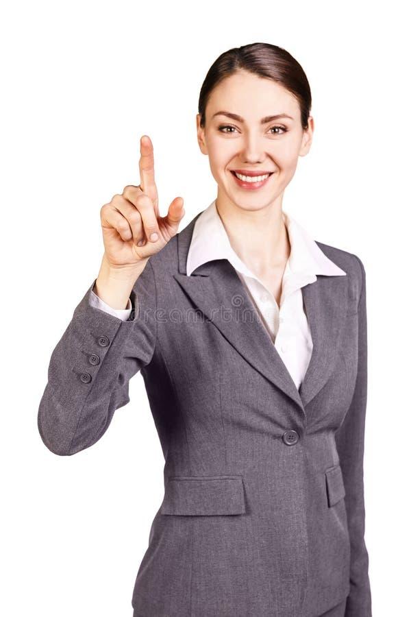 Mulher de negócios moreno que mostra o dedo indicador imagem de stock royalty free