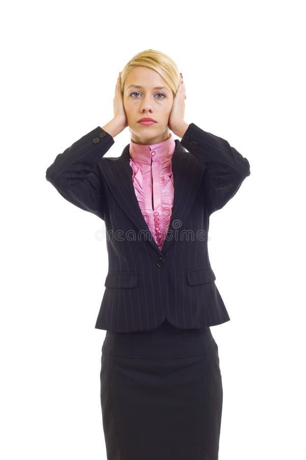 Mulher de negócios na audição nenhum pose mau imagem de stock royalty free