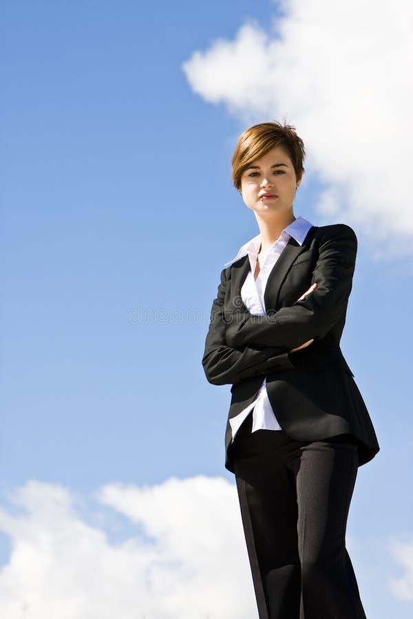 Mulher de negócios na parte superior fotografia de stock