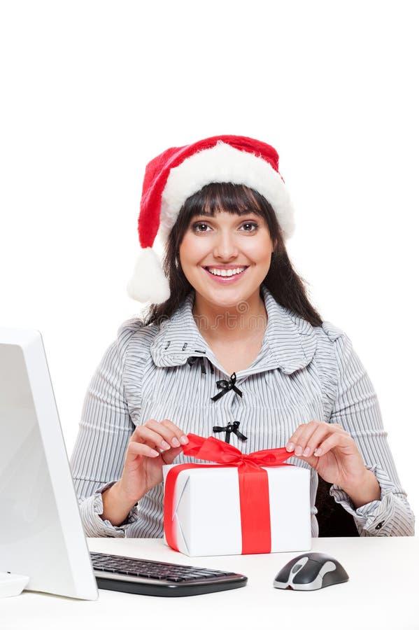 Mulher de negócios no chapéu de Santa fotografia de stock