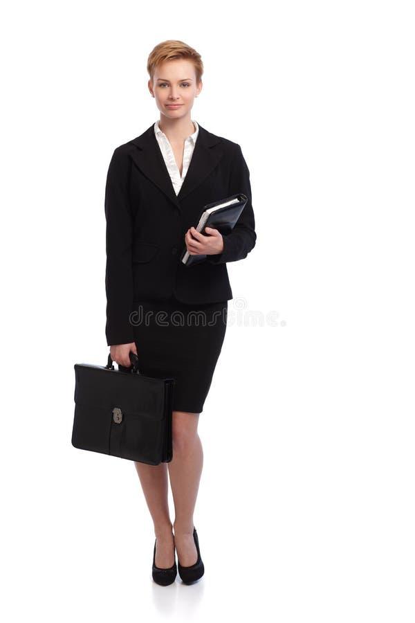 Mulher de negócios no preto imagem de stock