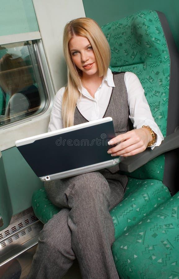 Mulher de negócios no trem imagens de stock