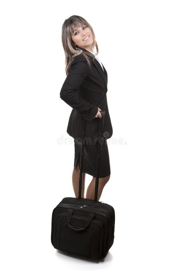 Mulher de negócios nova bonita com bagagem de mão fotografia de stock royalty free
