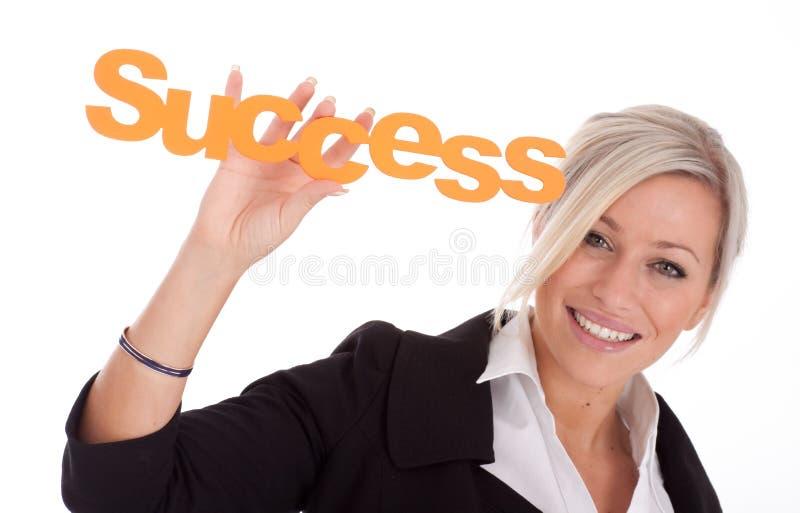 A mulher de negócios nova bonita prende o sucesso fotos de stock royalty free