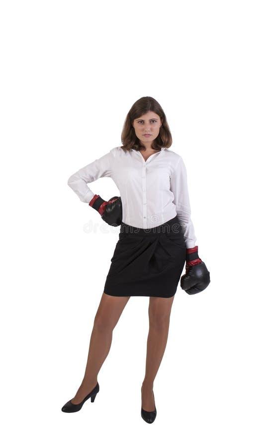 Mulher de negócios nova com as luvas de encaixotamento prontas para o conflito imagens de stock royalty free