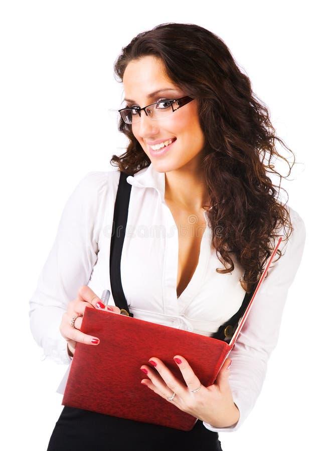 Mulher de negócios nova com dobrador fotos de stock royalty free
