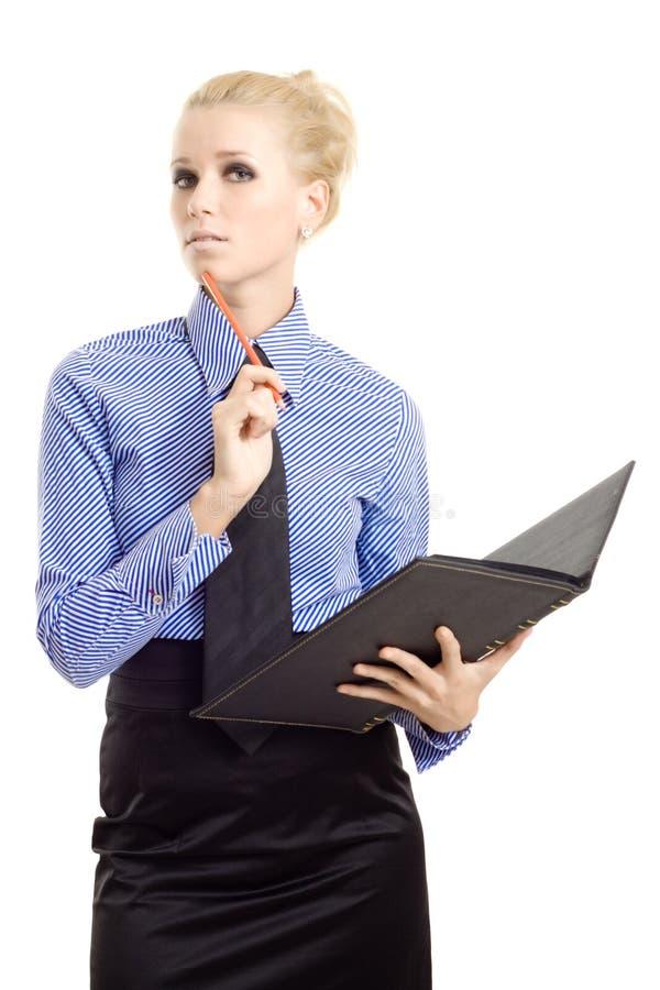 Mulher de negócios nova com lápis do livro imagens de stock