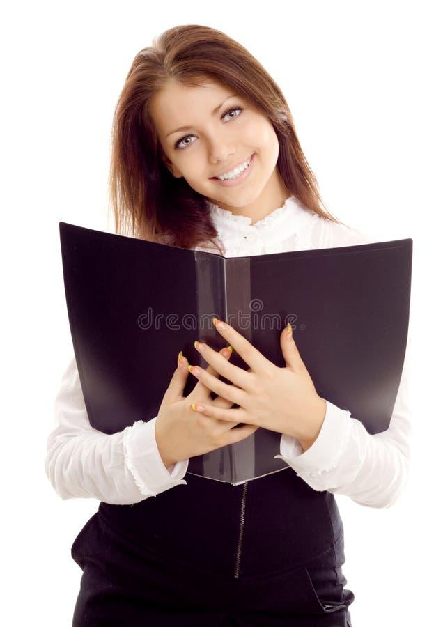 Mulher de negócios nova com livro fotos de stock royalty free