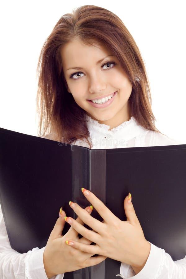 Mulher de negócios nova com livro fotografia de stock