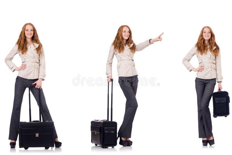 A mulher de negócios nova com a mala de viagem isolada no branco fotos de stock