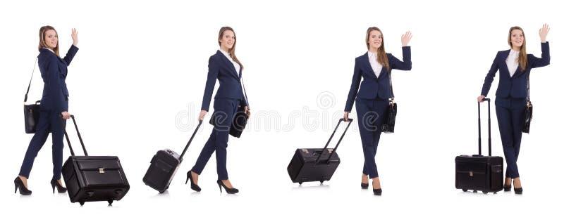A mulher de negócios nova com a mala de viagem isolada no branco fotos de stock royalty free