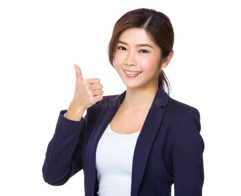 Mulher de negócios nova com polegar acima foto de stock