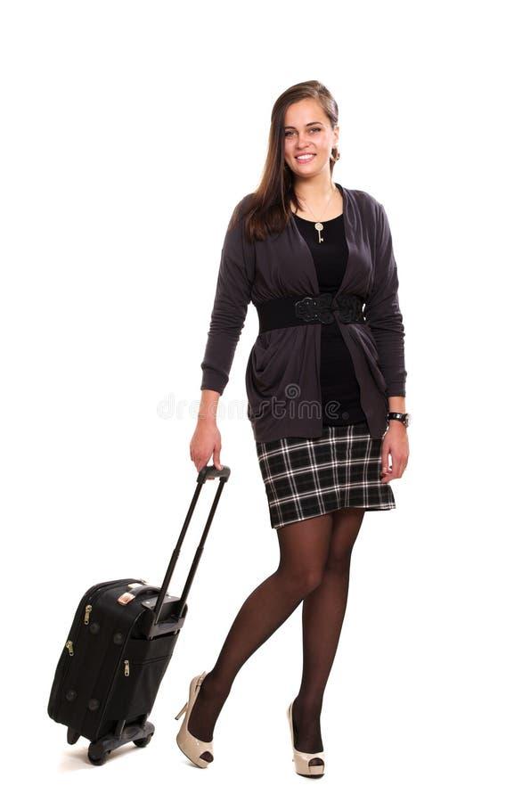 Mulher de negócios nova com uma mala de viagem fotografia de stock