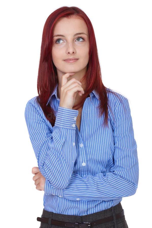 A mulher de negócios nova confusa, prende seu queixo imagens de stock