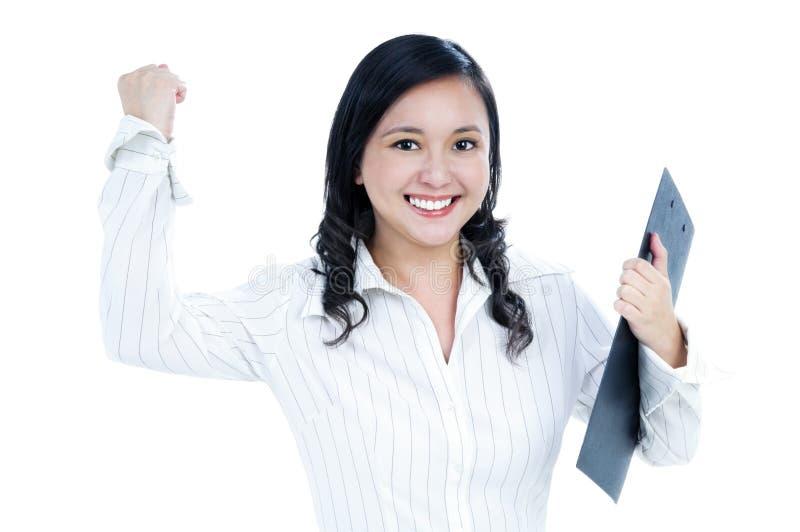 Mulher de negócios nova Excited que aperta seu punho fotos de stock royalty free