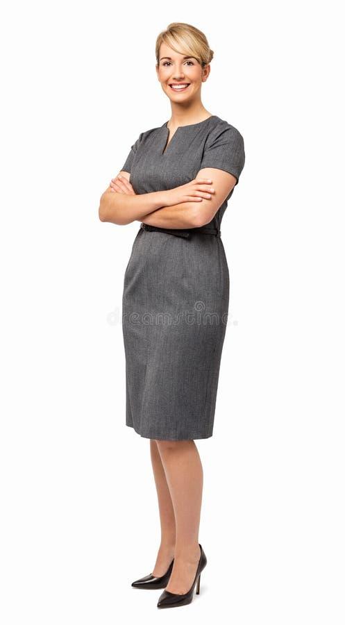 Mulher de negócios nova feliz With Arms Crossed fotos de stock royalty free