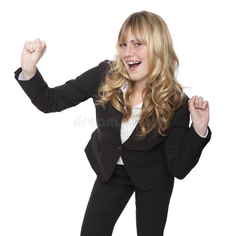 Mulher de negócios nova que comemora fotografia de stock