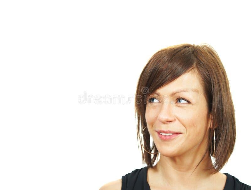 Mulher de negócios nova que olha no futuro imagem de stock