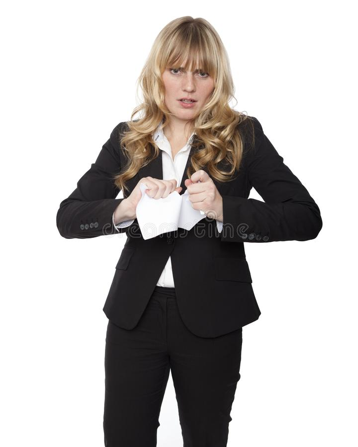 Mulher de negócios nova que rasga acima um original fotos de stock royalty free