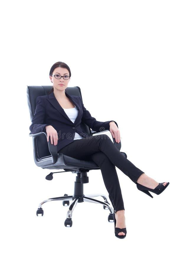 Mulher de negócios nova que senta-se na cadeira isolada no branco fotos de stock royalty free