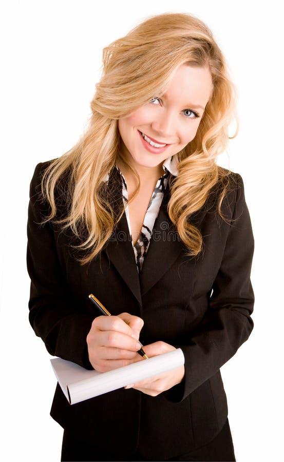 Mulher de negócios nova que toma notas imagens de stock