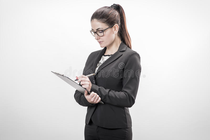 Mulher de negócios nova que toma notas fotos de stock royalty free