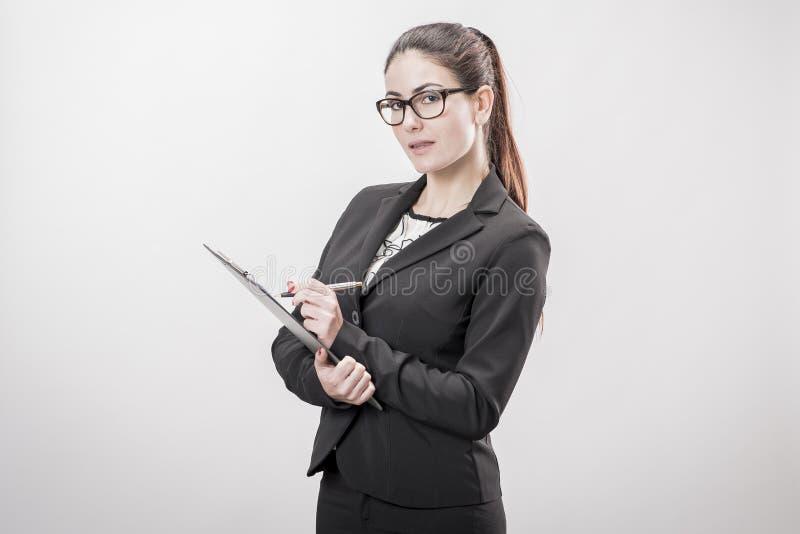 Mulher de negócios nova que toma notas imagem de stock royalty free