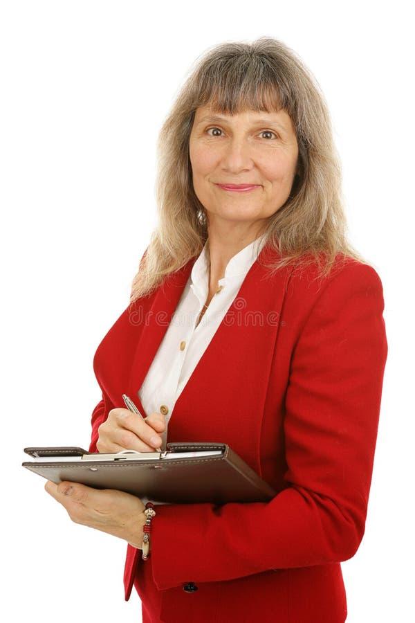 Mulher de negócios ou corretor de imóveis maduro imagens de stock royalty free