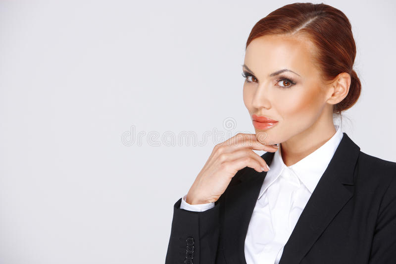 Mulher de negócios pensativa atrativa imagem de stock