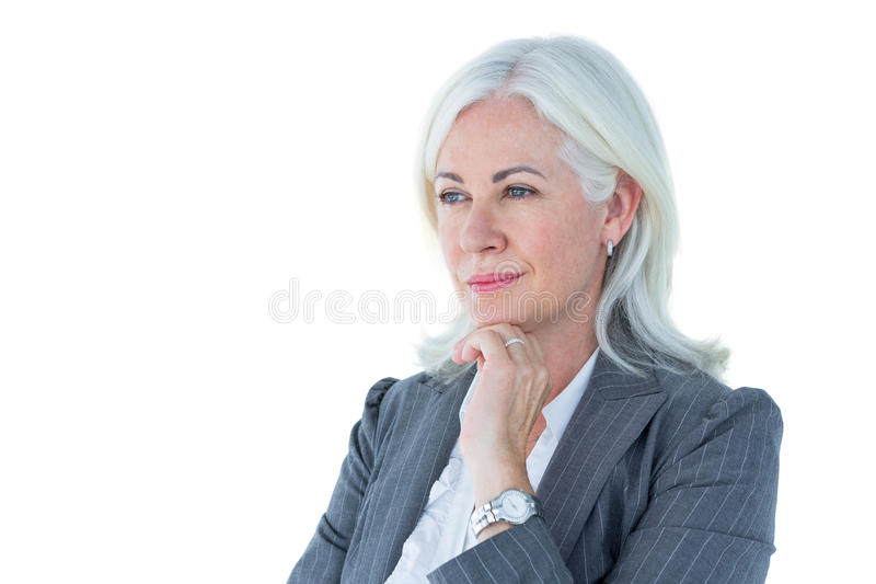 Mulher de negócios pensativa que toca em seu queixo imagens de stock