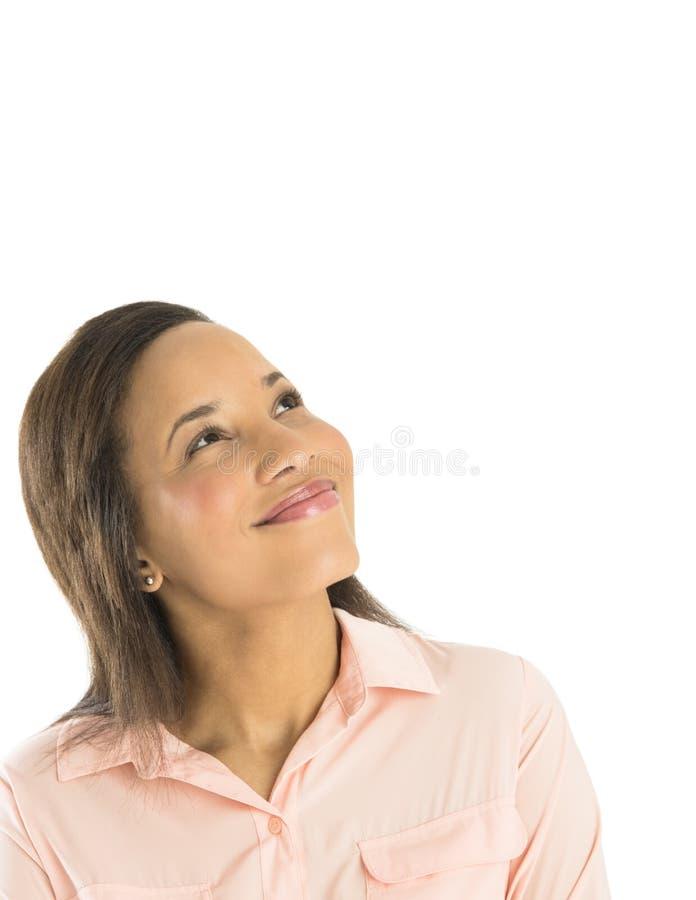 Mulher de negócios pensativa Smiling While Looking acima imagem de stock royalty free