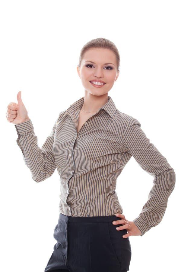 Mulher de negócios positiva que mostra o bom sinal imagem de stock