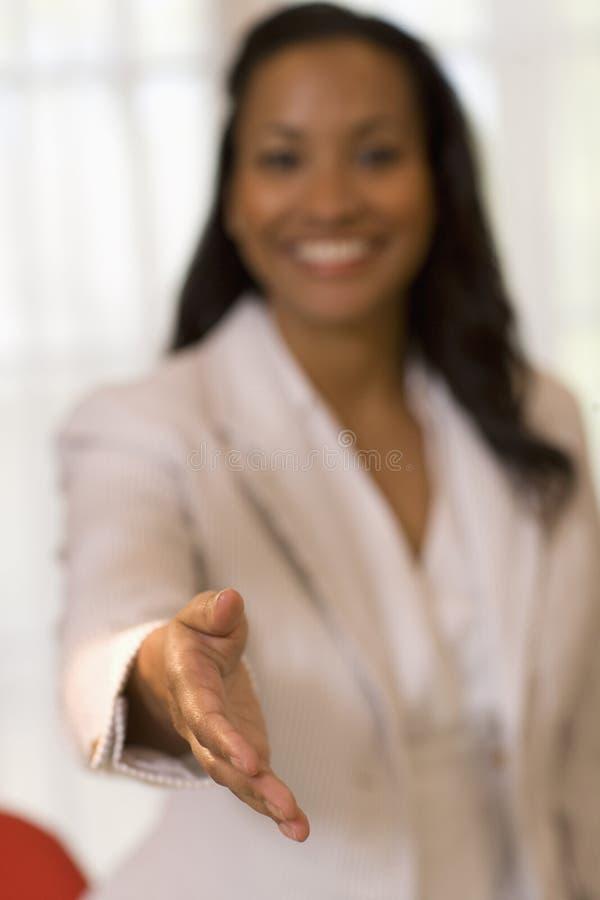 Mulher de negócios pronta para agitar as mãos fotos de stock royalty free