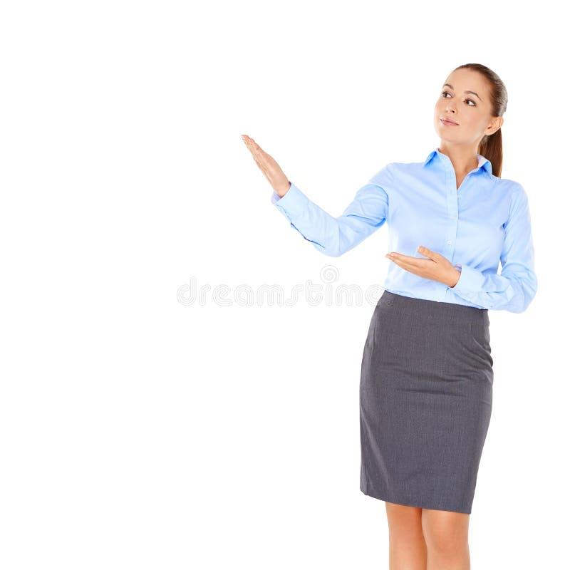 Mulher de negócios que aponta à esquerda foto de stock