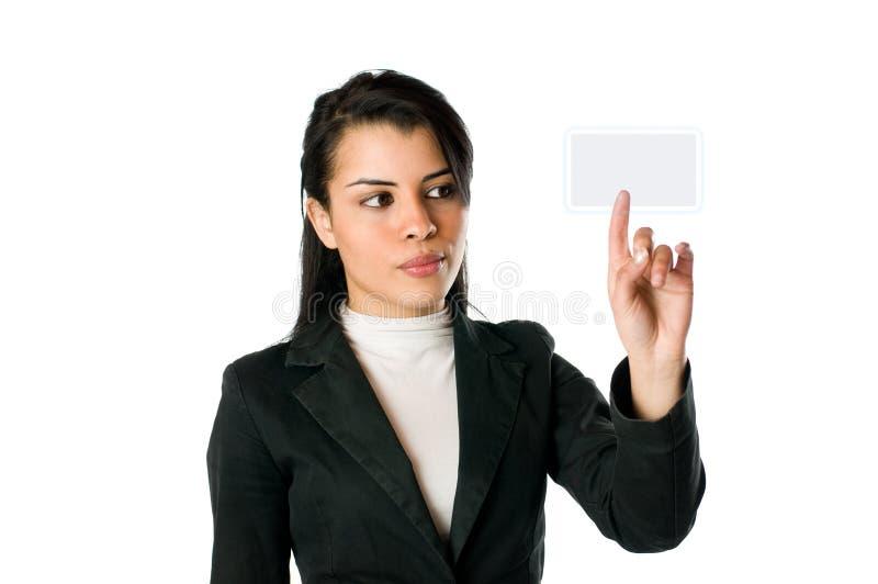 Mulher de negócios que empurra uma tecla fotografia de stock royalty free