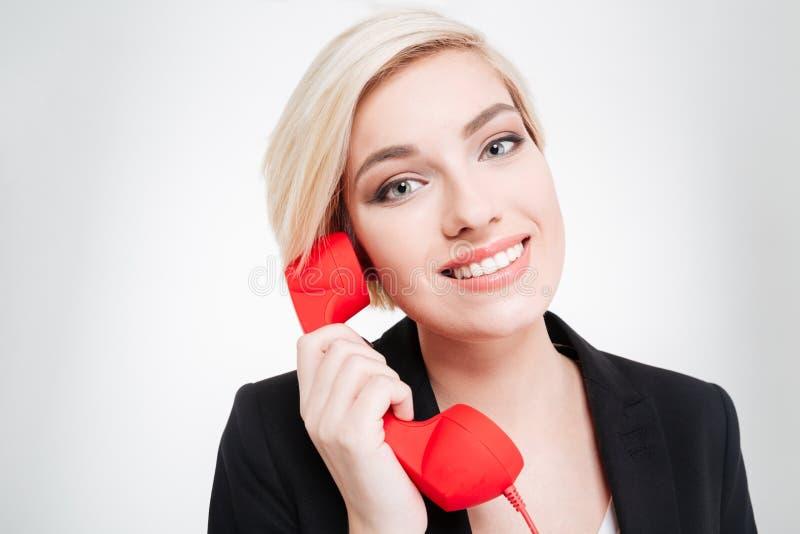 Mulher de negócios que fala no tubo retro do telefone imagem de stock royalty free