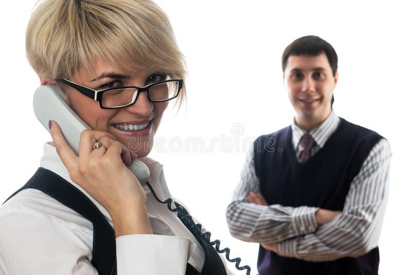 Mulher de negócios que fala pelo móbil imagem de stock royalty free