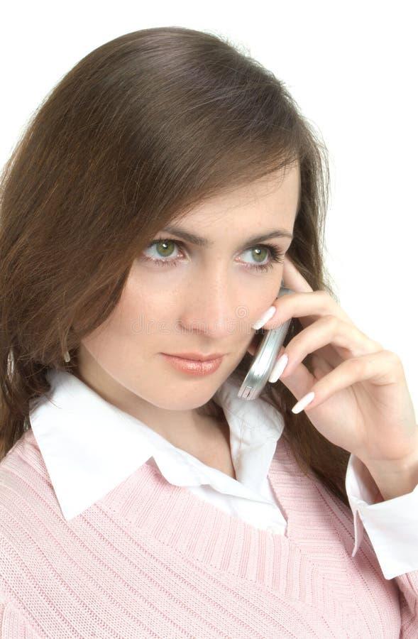 Mulher de negócios que fala pelo telefone de pilha imagem de stock