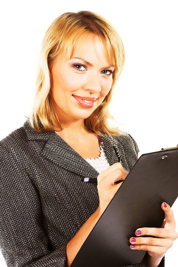 Mulher de negócios que faz anotações imagens de stock