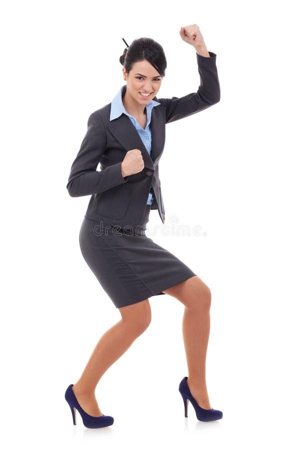 Mulher de negócios que ganha sobre o branco fotografia de stock
