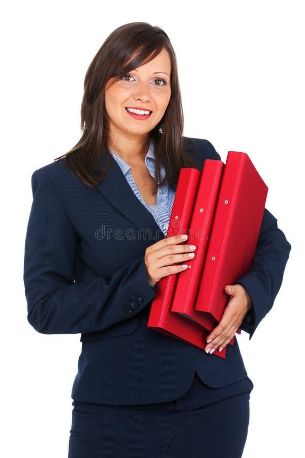 Mulher de negócios que guarda dobradores imagens de stock