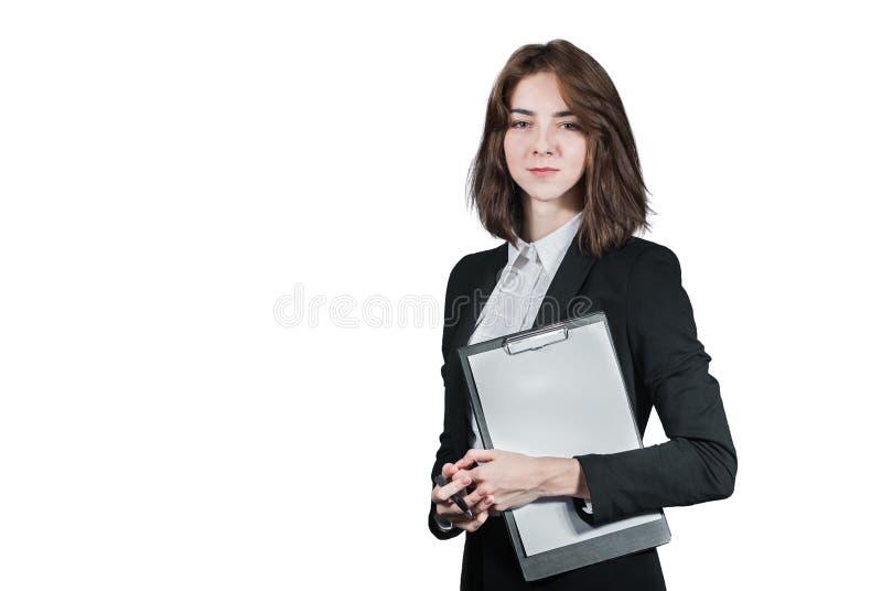 Mulher de negócios que guarda a prancheta em sua mão fotos de stock royalty free