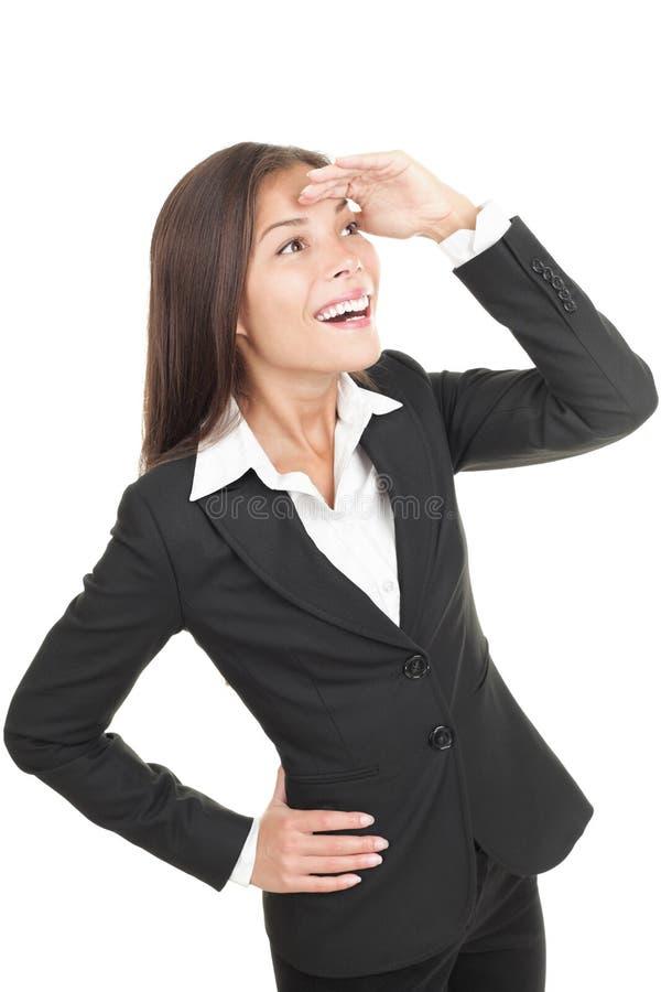 Mulher de negócios que olha afastado com antecipação foto de stock royalty free