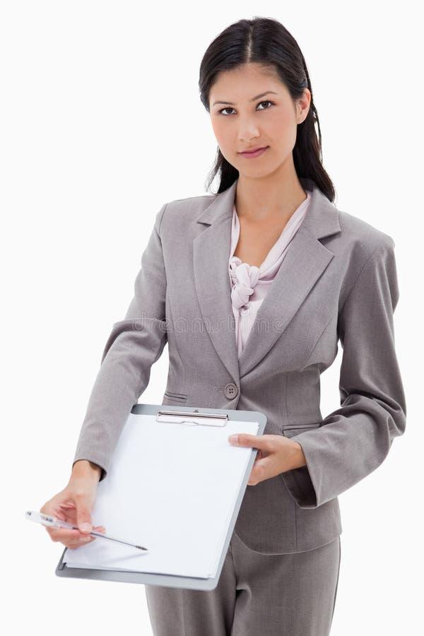 Mulher de negócios que pede a assinatura foto de stock royalty free