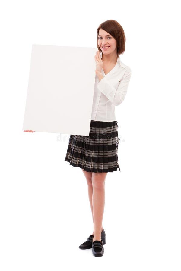 Mulher de negócios que prende a placa em branco fotografia de stock royalty free
