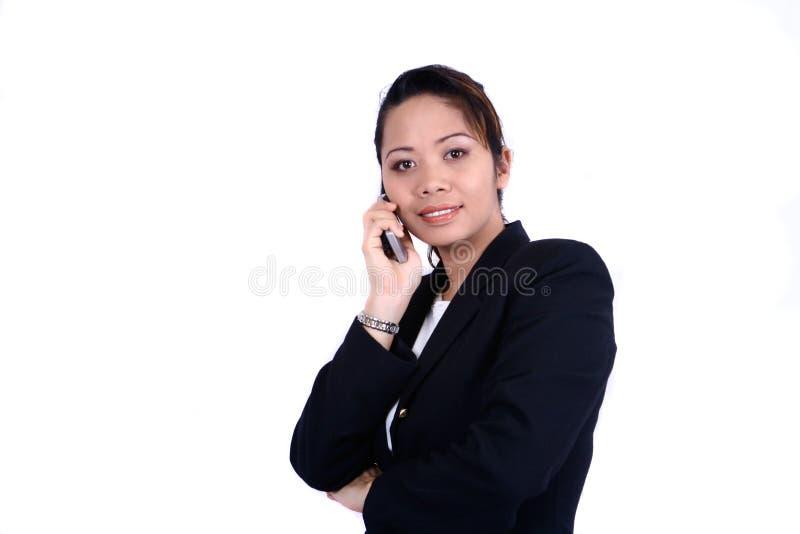 Mulher de negócios que prende um telefone imagens de stock royalty free