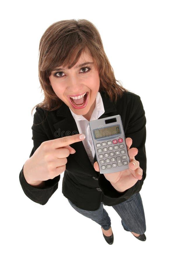 Mulher de negócios que prende uma calculadora imagem de stock